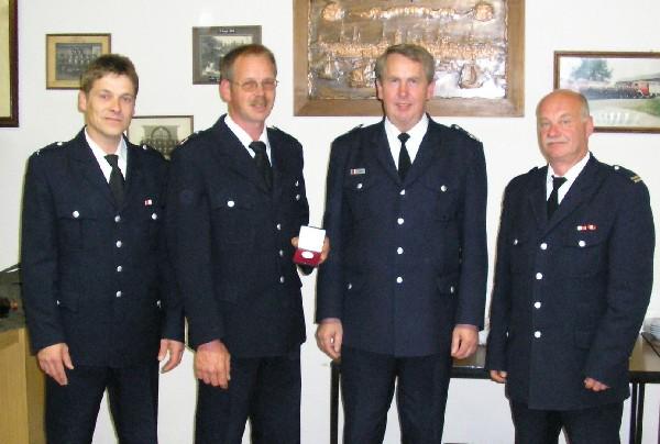 Norbert Kahl (zweiter von links)mit WFV Thomas Albers (links), BERF Peter Röhe und WF Klaus Erdland (rechts).