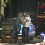 Evakuierte Hausbewohner stehen sichtlich unter Schock