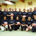 Feuerwehrleute der FF Süsel freuen sich über den neuen Leitfaden Feuerwehrsport  Quelle und Copyright: HFUK Nord